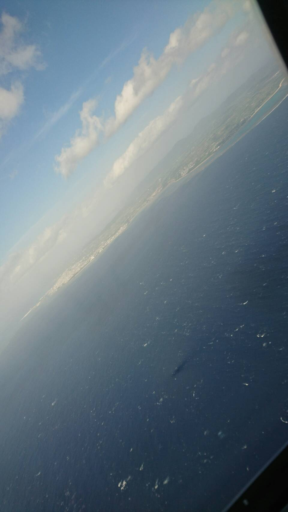 初日機内着陸前海.jpg